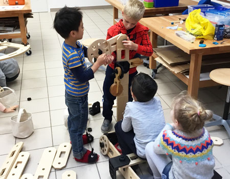 Grade 1 students building a vehicle in Maker Space