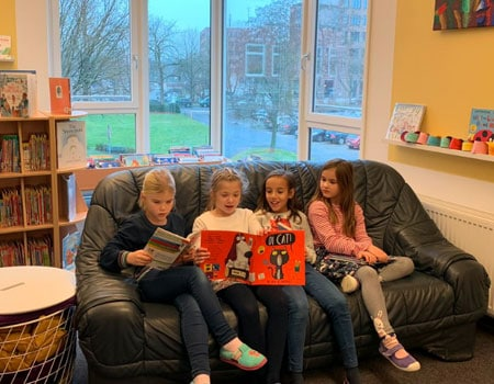 Grade 2 students reading in library