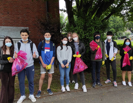 Grade 10 students cleaning up as CAS activity