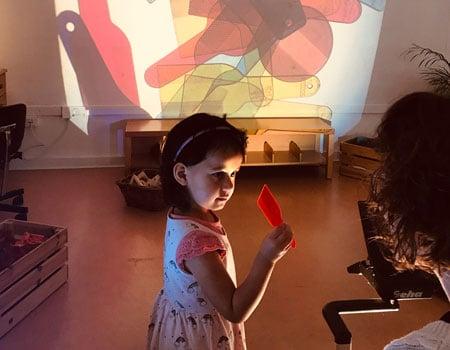 Kindergarten student with lightbox
