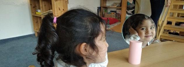 Kindergarten student in mirror