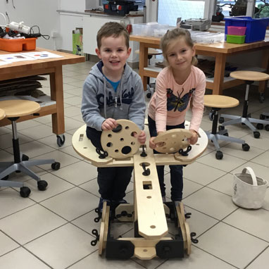Grade 1 students with their self-built vehicle