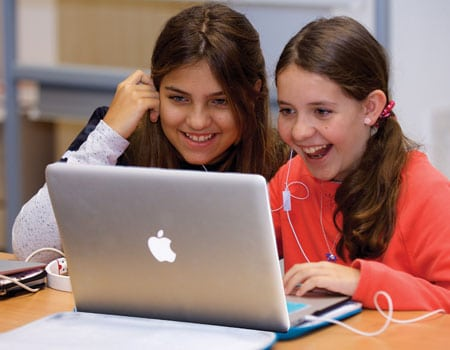 Middle School students working on MacBooks