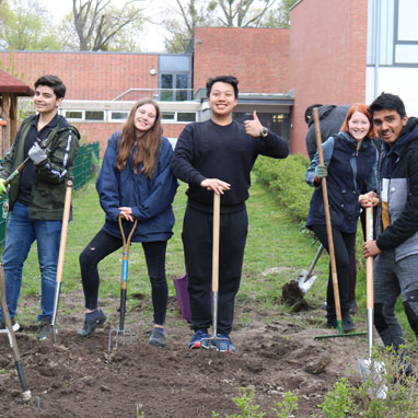 Secondary students working in Growing Garden