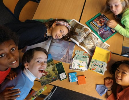 Grade 5 students with books