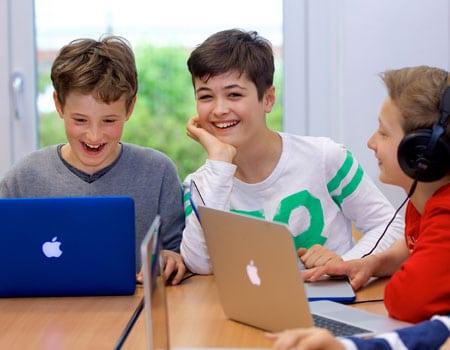 ISHR Middle School students using MacBooks